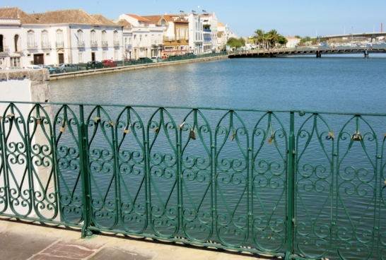 newer side of river - iron fence with lovers locks, Tavira, Portugal