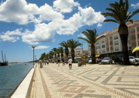 cobblestone walkway along marina, Lagos, Portugal