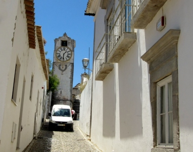 clock tower and narrow streets, Tavira, Portugal