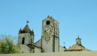 clock tower and weathervanes - historic Tavira, Portugal