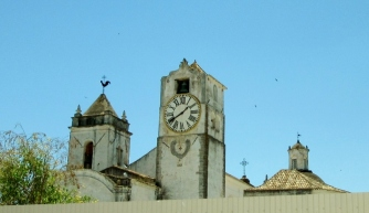 clock tower and weathervanes - historic Tavira, Portugal