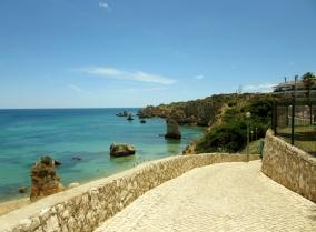 cobblestone road and ocean view, Praia da Luz, Portugal
