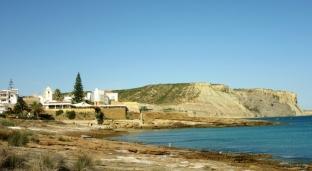 cliffs and houses along ocean, Praia da Luz, Portugal