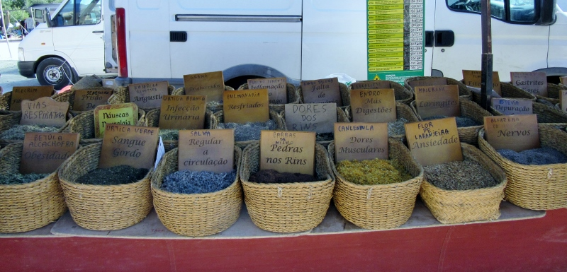 street market and herbal medicines, Paderne, Portugal