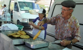 frying bread and dipping in sugar, Paderne, Portugal