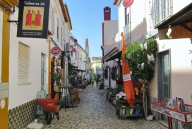 narrow street and shops, Ferragudo, Portugal
