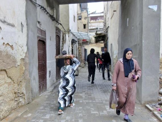 Jewish Quarter-women in djellaba. Fez, Morocco