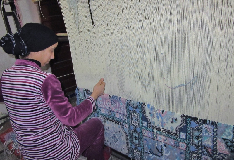 weaving a traditional rug