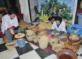 women cracking nuts for Argan oil. Fez, Morocco