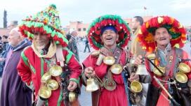 Colorfully dressed Berver vendors. Marrakesh medina plaza, Morocco