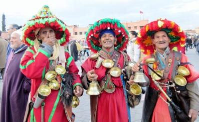 Berber vendors colorfully dressed in Marrakesh, Morocco