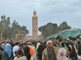 The mosque in the evening and crowds at Marrakesh's plaza