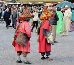 Berbers, colorfully dressed In the Marrakesh Medina Plaza, Morocco.