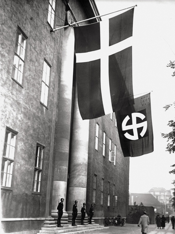 Danish and Nazi Germany flags fly side by side Source