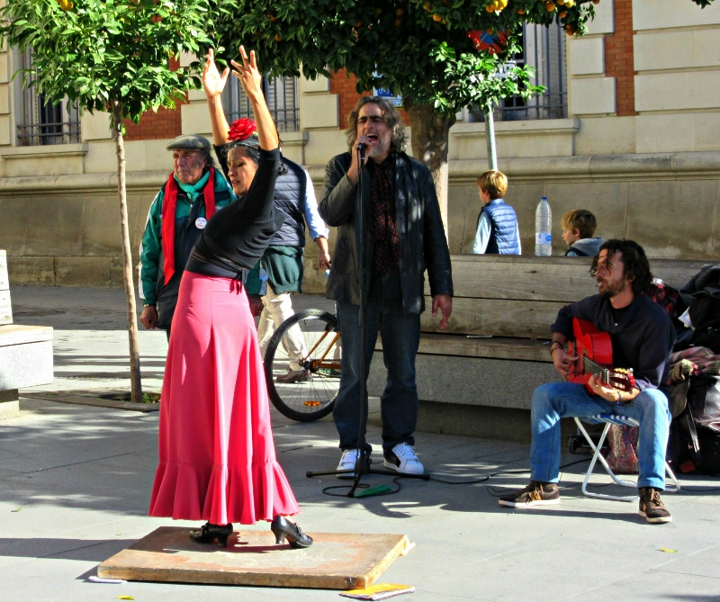 Flamenco dancer and musicians. Seville. Photo by No Particular Place To Go