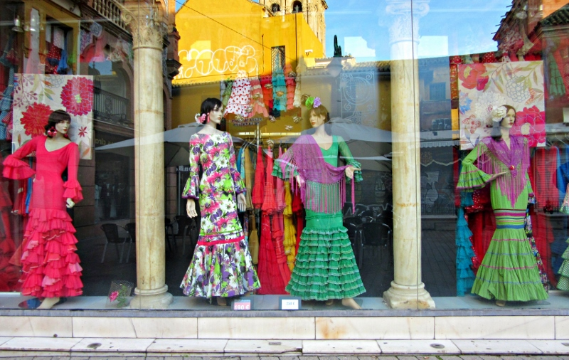 Flamenco dresses displayed in a shop.