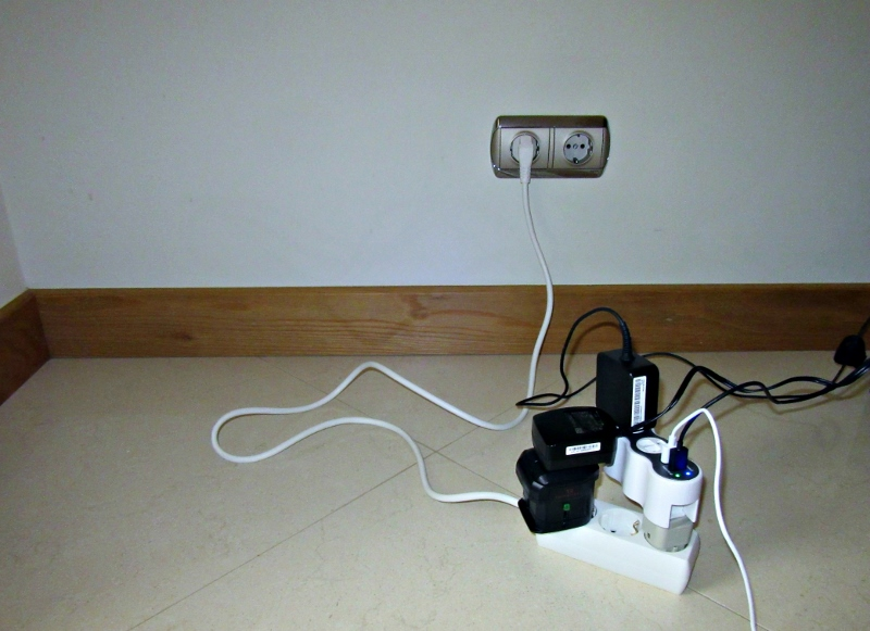 Inelegant extension cord, adapter and surge protector. Photo by No Particular Place To Go
